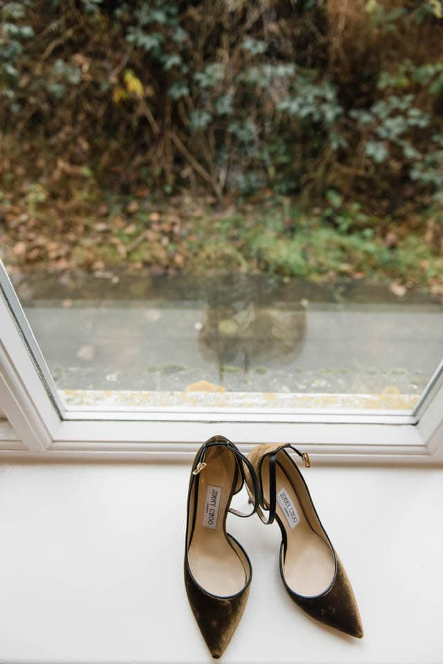 Velvet Jimmy Choo wedding shoes on windowsill
