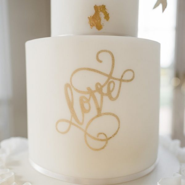 gold leaf and calligraphy wedding cake