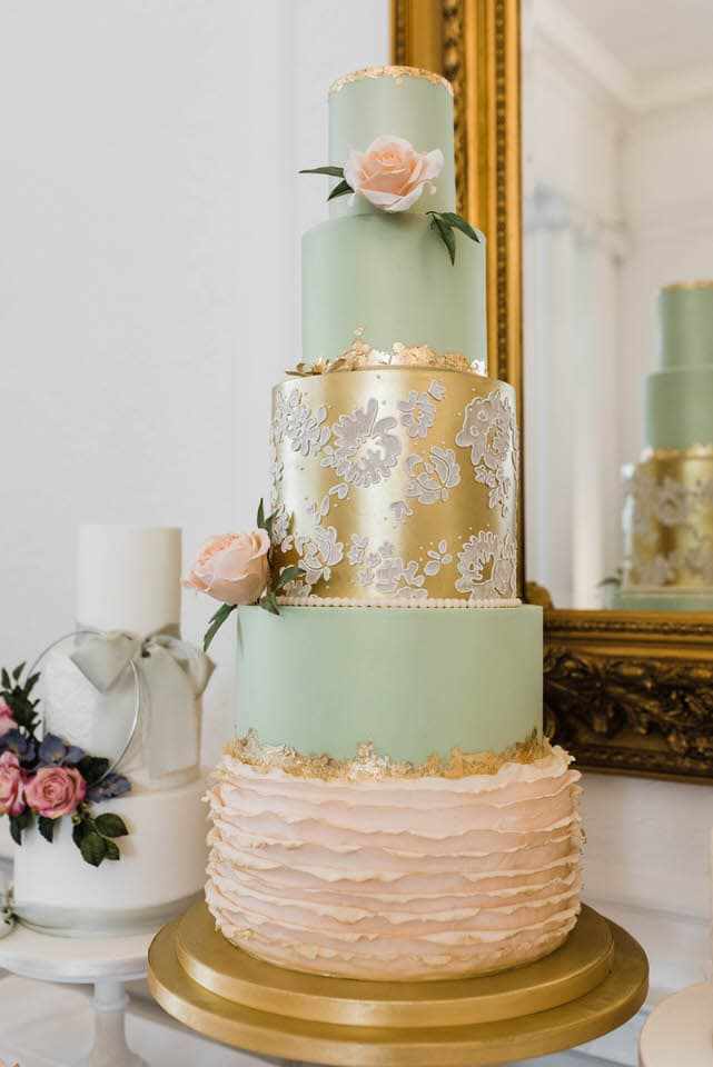 Gold, green and pink stencilled wedding cake