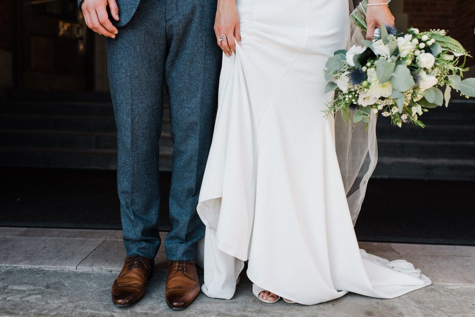 Close up of bride and groom legs