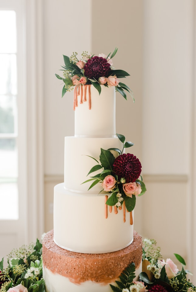 white & copper wedding cake with drip detail