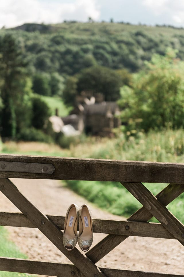jimmy choo bridal shoes on a gate in Yorkshire