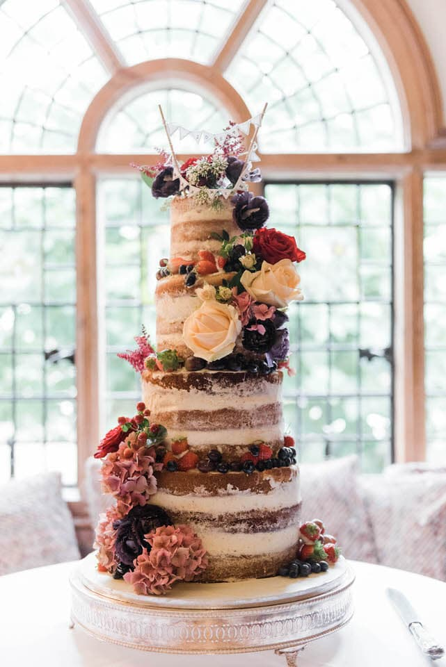 naked cake with flowers and fruit