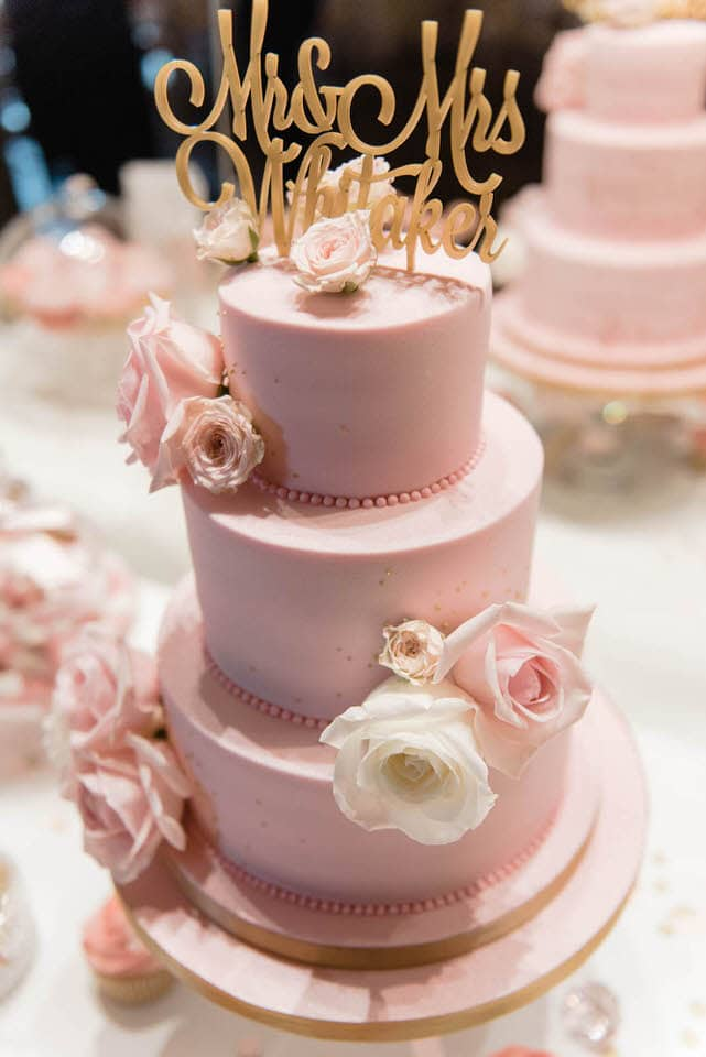 3 tier pink wedding cake with gold cake topper