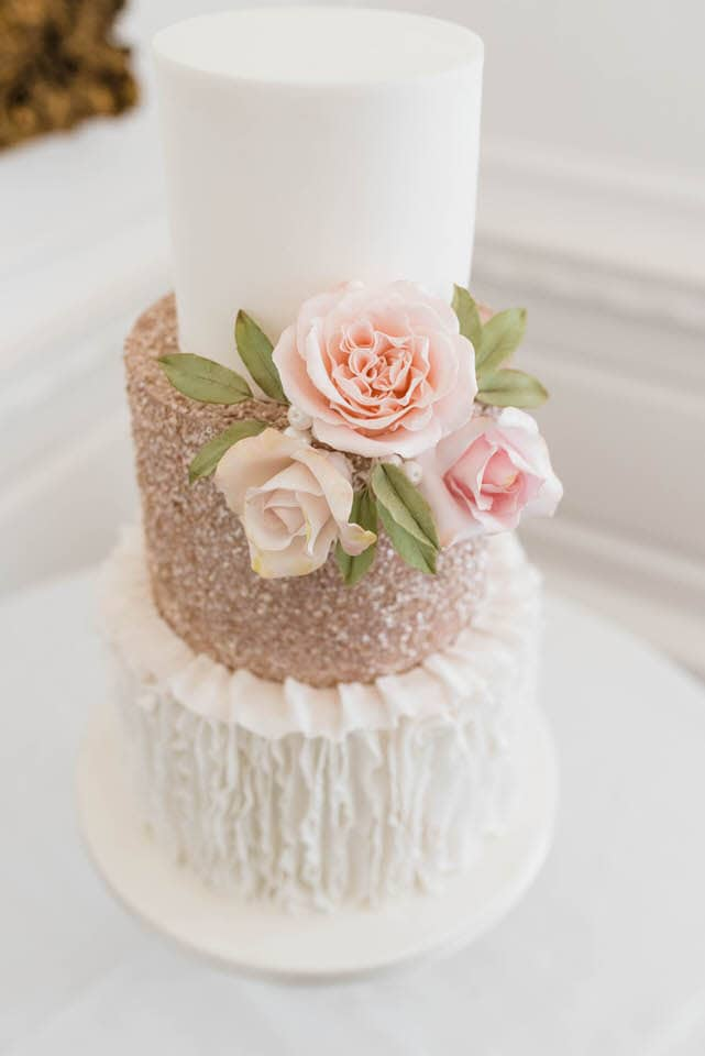 pink and white glitter wedding cake with pink roses