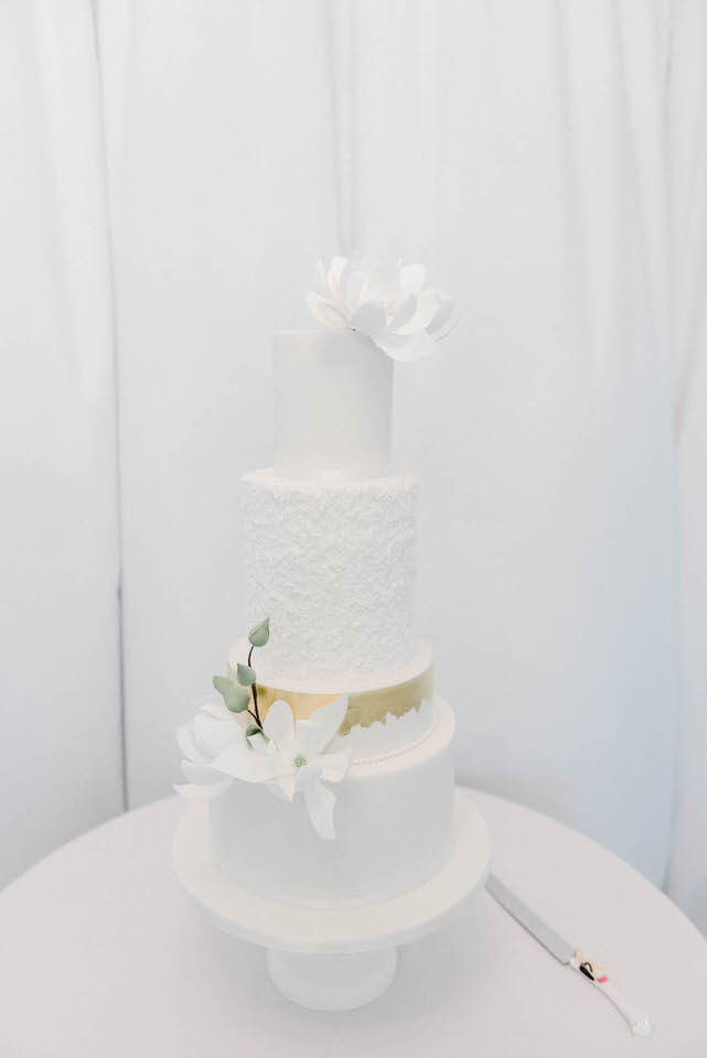 4 Tier white wedding cake with gold foil