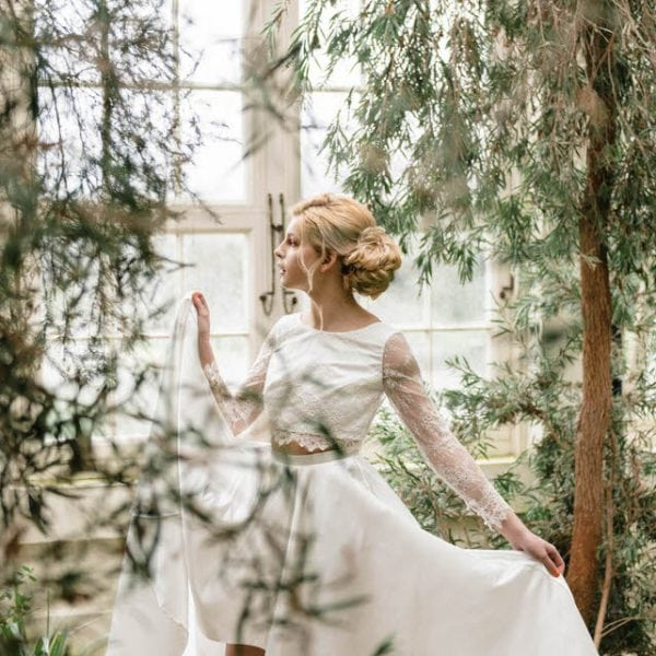 Bride holding skirt in botanical gardens Sheffield