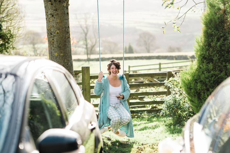 Bride sitting on swing in North Yorkshire