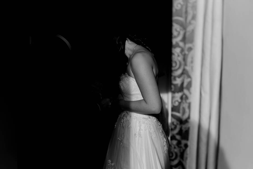 bride in dress in shadows
