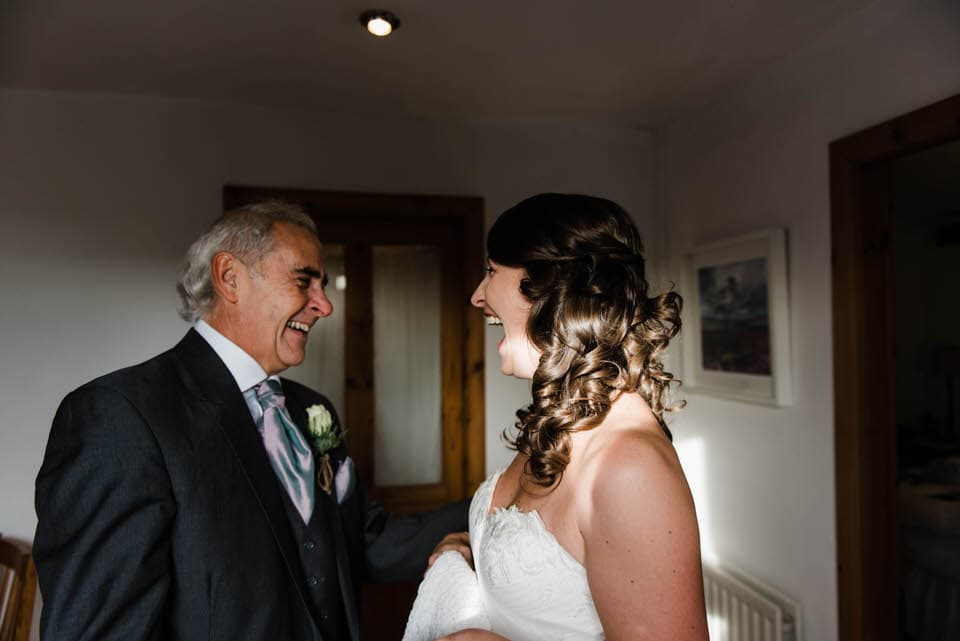 Bride and dad laughing at Yorkshire wedding