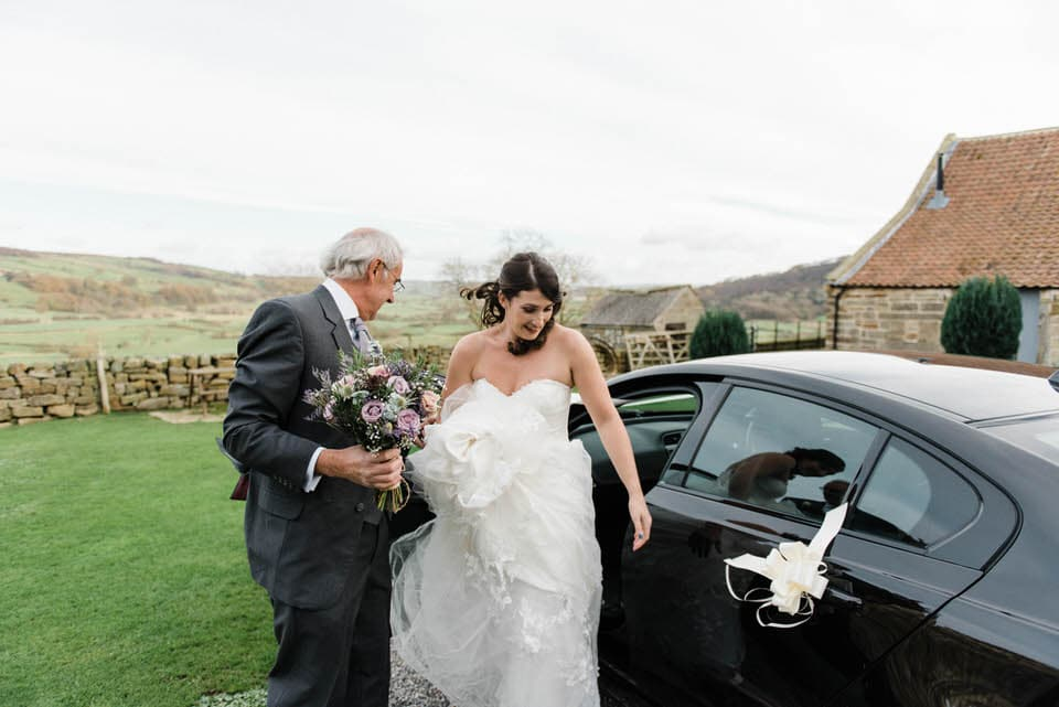 bride arriving at Danby Castle wedding