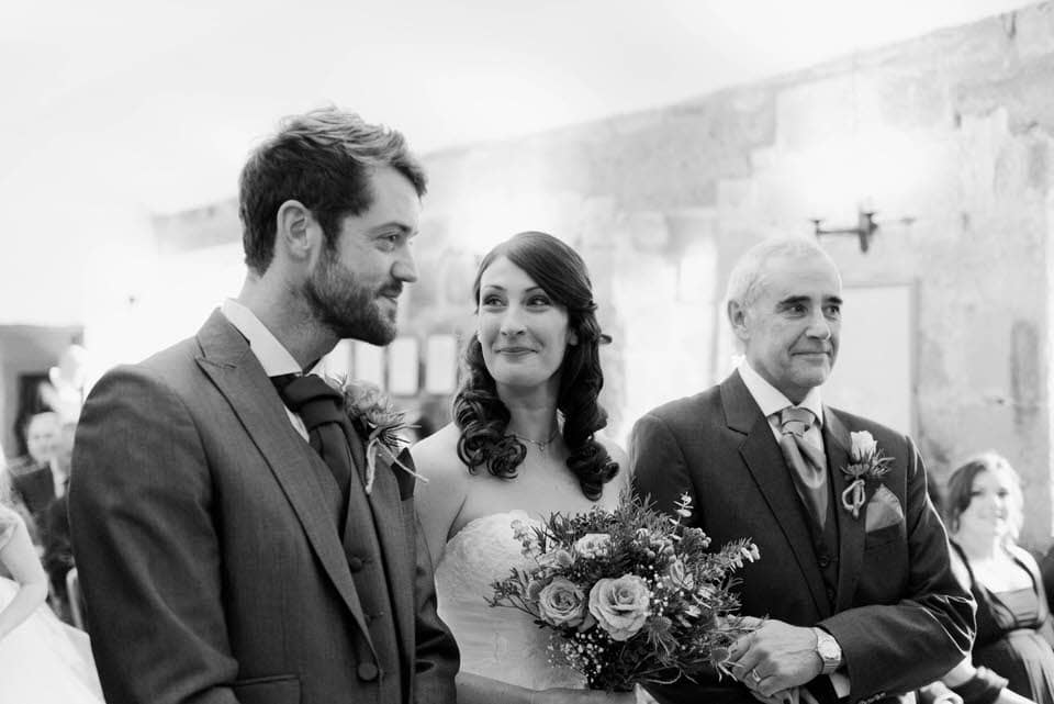 bride, groom and dad at Danby Castle wedding ceremony