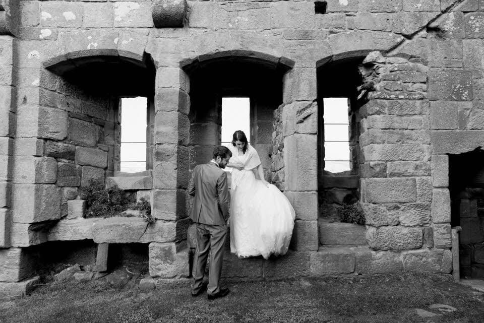 bride and groom in ruins at Danby castle wedding
