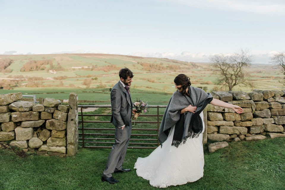 bride and groom overlooking north yorkshire moors at danby castle