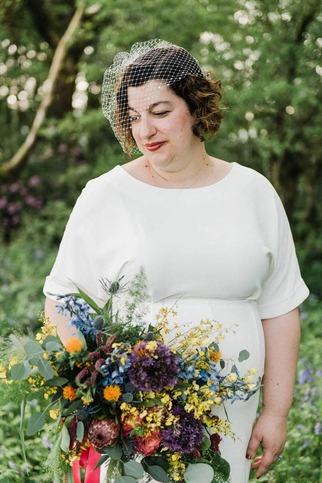Bride with flowers at elopement